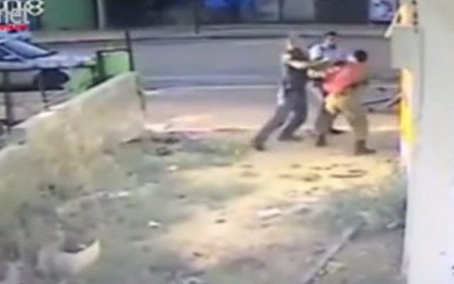 File: Video footage showing policemen pummeling an Ethiopian-born IDF soldier, Damas Pakada, who alleged he was the target of a racist attack. (screen capture: YouTube)