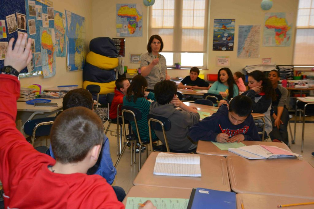 Tracy Sockalosky leading a discussion with her seventh-grade class at Wilson Middle School in Natick, Massachusetts. (Courtesy of Tracy Sockalosky/JTA)