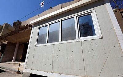 A picture taken on April 12, 2015 shows bullet holes in the guard post in front of the South Korean Embassy in the Libyan capital Tripoli following a gunmen attack on the embassy compound.  (AFP/ MAHMUD TURKIA)