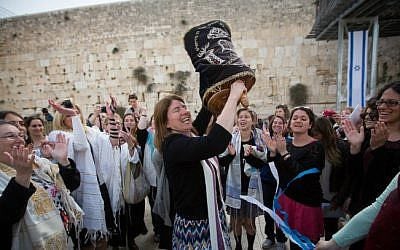 Illustrative photo of women dancing with a Torah scroll at the Western Wall, April 20, 2015. (Miriam Alster/Flash90)