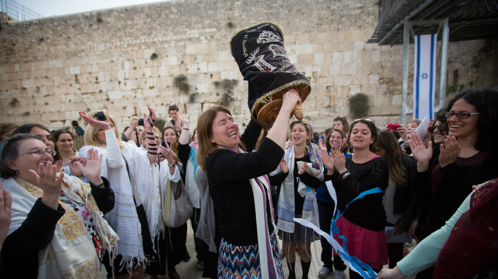 Women dance with a Torah scroll at the Western Wall, on April 20, 2015 (photo credit: Miriam Alster/Flash90