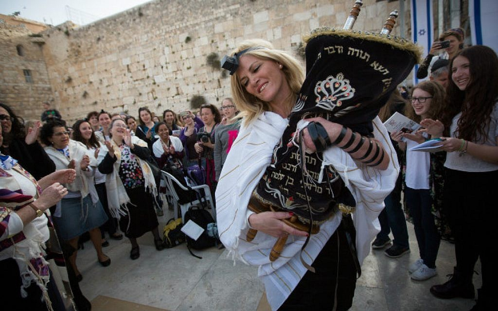 Women dance with a Torah scroll as they attend a monthly prayer service at the Western Wall, Judaism's holiest site, on April 20, 2015. (Miriam Alster/Flash90)