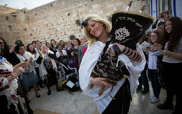 Women dance with a Torah scroll as they attend a monthly prayer service at the Western Wall, Judaism's holiest site, on April 20, 2015 (photo credit: Miriam Alster/Flash90)