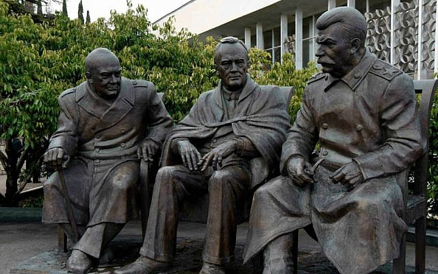 A February 5, 2015 photo of a statue commemorating the 1945 Yalta Conference between Churchill, left, Franklin Delano Roosevelt, center, and Joseph Stalin (photo credit: AP Photo/ Alexander Polegenko)