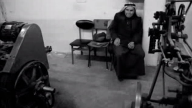 Yasser Hirbawi in his Hebron-based textile mill that produces Palestinian-made keffiyehs. (screen capture: YouTube)