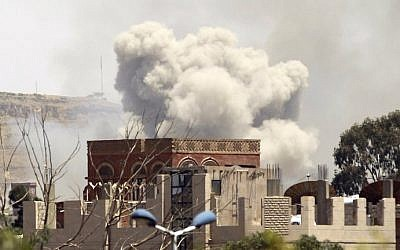 Smoke rises above the Alhva camp, east of the Yemeni capital, Sanaa, on April 17, 2015, following an alleged air strike by the Saudi-led alliance on Shiite Houthi rebels camps. (photo credit: AFP/Mohammed Huwais)