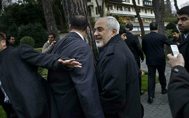Iranian Foreign Minister Javad Zarif talks to members of the media while walking through a courtyard at the Beau Rivage Palace Hotel during an extended round of talks April 1, 2015 in Lausanne, Switzerland, (photo credit: AP Photo/BRENDAN SMIALOWSKI/POOL)