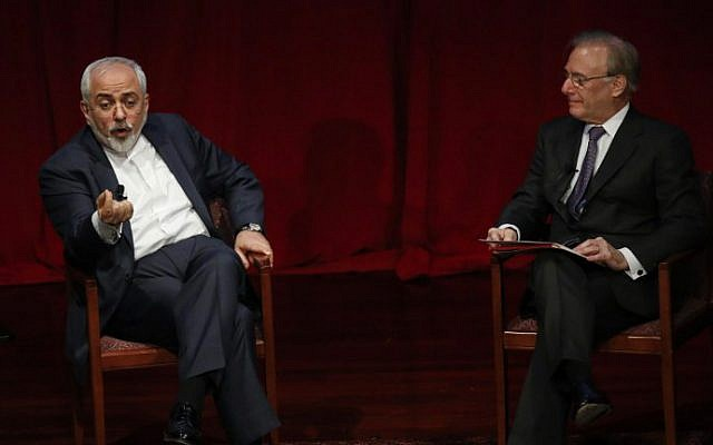 Mohammad Javad Zarif, Iran's foreign minister, talks to David Ignatius during a public event at New York University on April 29, 2015 (photo credit: AFP/ KEAN BETANCUR)