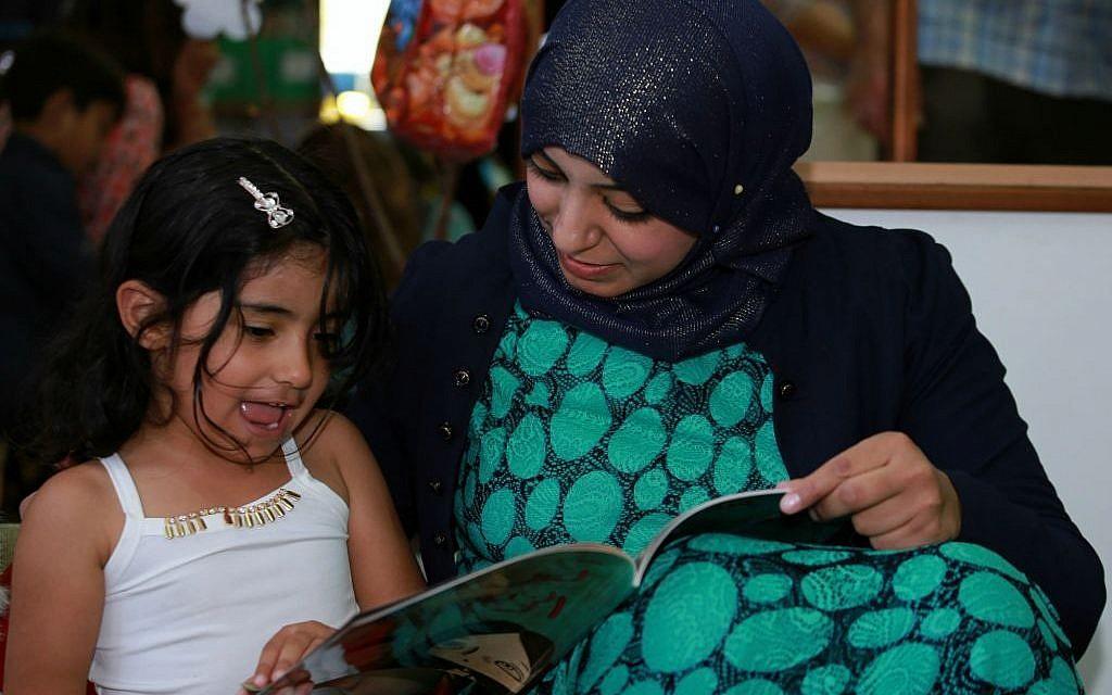 Maktabat al-Fanoos (Lantern Library) book program stimulates shared reading between parent and child. (photo credit: Rami Jabareen)