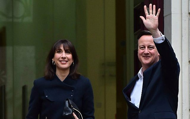 British Prime Minister David Cameron (R) and his wife Samantha arrive at Conservative Party headquarters in London on May 8, 2015, the day after a general election. (AFP Photo/Ben Stansall)