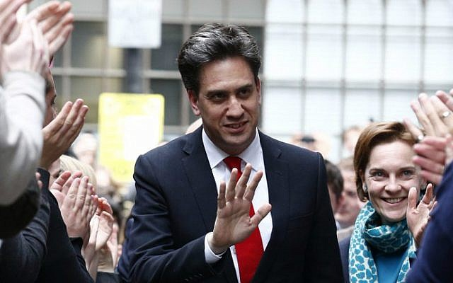 Labour Party leader Ed Miliband (C) and his wife Justine Thornton arrive at Labour Party headquarters in London on May 8, 2015, the day after a crushing general election defeat. (AFP Photo/Justin Tallis)