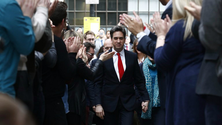 Labour party leader Ed Miliband (center) and his wife Justine Thornton arrive at Labour party headquarters in London on May 8, 2015, the day after a general election. (AFP Photo/Justin Tallis)