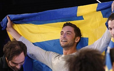 Sweden's Mans Zelmerlow reacts after winning the Eurovision Song Contest final on May 23, 2015 in Vienna.  (AFP PHOTO / DIETER NAGL)