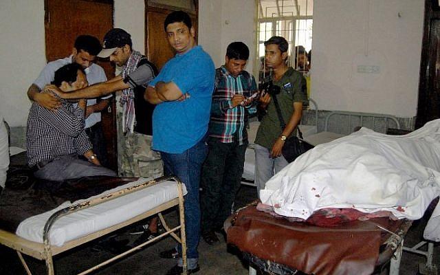 Relatives of deceased Bangladeshi blogger Ananta Bijoy Das react after seeing his body in Sylhet on May 12, 2015. (photo credit: AFP)
