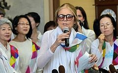 US activist Gloria Steinem (C) speaks to the media as her group of peace activists arrives at the inter-Korea transit office after they crossed the border line through the demilitarized zone (DMZ) separating the two Koreas in Paju on May 24, 2015. (AFP/Jung Yeon-Je)