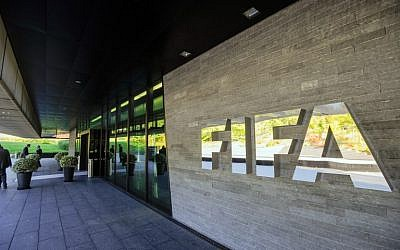 This file photo taken on September 3, 2013 shows the logo of the FIFA (International Federation of Association Football) outside the organisation's headquarters in Zurich. (AFP PHOTO / FILES / SEBASTIEN BOZON)