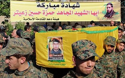 Hezbollah fighters carry the coffin of fellow Shiite fighter Hamza Hussein Zeiter during his funeral on May 5, 2015 in the town of Baalbek in eastern Lebanon's Bekaa Valley. The Hezbollah fighter was killed during clashes with members of Al-Nusra Front in the Syrian region of Qalamoun. (AFP)