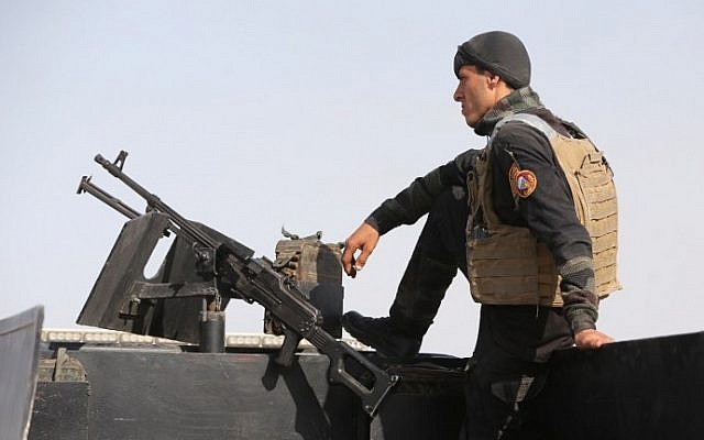 A member of the Iraqi interior ministry's anti-terrorism forces stands guard on a vehicle near Anbar province's capital Ramadi, on May 8, 2015. The city, including government headquarters therein, were taken over by Islamic State on Friday, May 15 2015, according to reports. (Photo credit: Ahmad al-Rubaye/AFP)