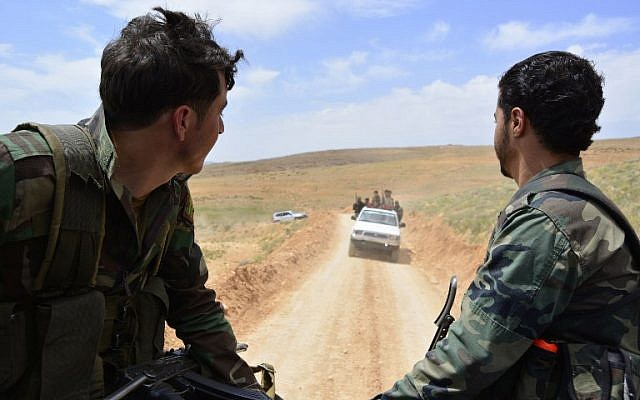 Syrian regime forces drive on May 9, 2015 in the Qalamun region, after they seized control of several hilltops in the mountainous area with the support of Lebanon's Shiite Hezbollah movement (AFP PHOTO / STR)