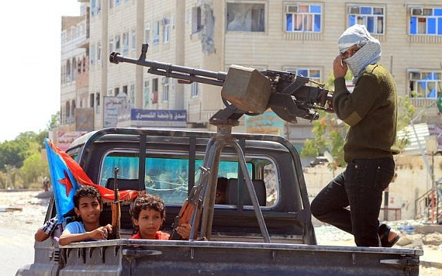File photo: Yemeni children holding rifles sit in the back of a heavily armed pick up truck with fighters loyal to Yemen's Saudi-backed President Abd Rabbo Mansour Hadi in the Dar Saad neighborhood of the southern Yemeni city of Aden on May 10, 2015, as they continue to battle Shiite Houthi rebels. (AFP/Saleh Al-Obeidi)