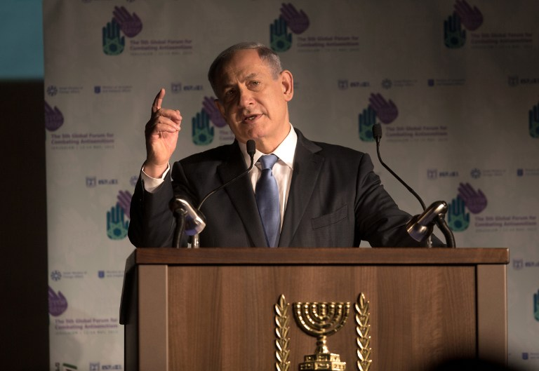 Israeli Prime Minister Benjamin Netanyahu delivers a speech at the 5th Global Forum for Combating Anti-Semitism conference at the International Convention Center in Jerusalem, on May 12, 2015. (photo credit: AFP PHOTO / MENAHEM KAHANA)