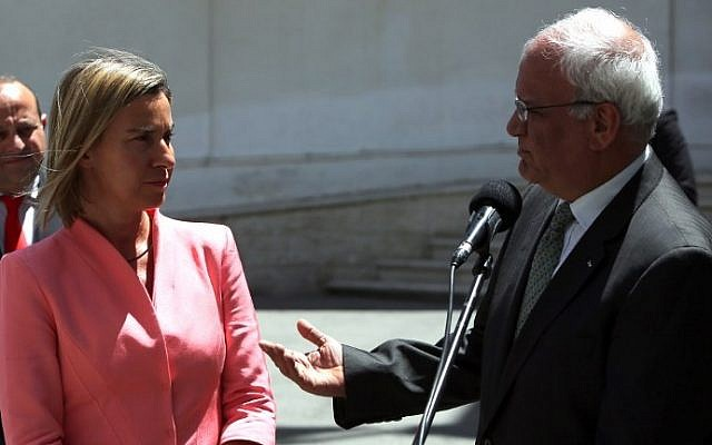 European Union foreign policy chief Federica Mogherini, left, and Saeb Erekat speak to the press in Ramallah, on May 20, 2015. AFP/ABBAS MOMANI)