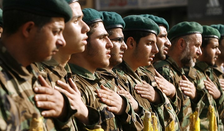 Hezbollah members mourn during the funeral of a comrade who was killed in combat alongside Syrian government forces in the Qalamun region, on May 26, 2015, in the southern Lebanese village of Ghaziyeh. (AFP PHOTO / MAHMOUD ZAYYAT)