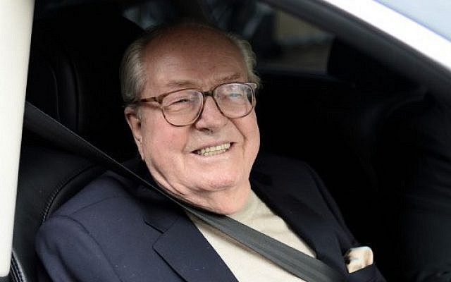 France's far-right party Front National (FN) honorary president Jean-Marie Le Pen smiles as he leaves the party's headquarters in Nanterre, near Paris, on May 4, 2015. (photo credit: AFP PHOTO / STEPHANE DE SAKUTIN)