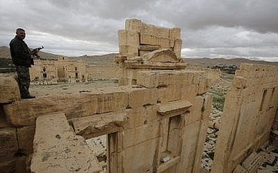A Syrian policeman stands above the sanctuary of Baal in the ancient oasis city of Palmyra on March 14, 2014. (Joseph Eid/AFP)
