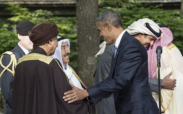 US President Barack Obama (center) says goodbye to the emir of Kuwait Sheikh Sabah al-Ahmad al-Jaber al-Sabah (2nd left) and Oman's Deputy Prime Minister Fahd bin Mahmud al-Said at the end of a summit meeting with leaders of the Gulf Cooperation Council (GCC) at Camp David in Maryland, on May 14, 2015. (Nicholas Kamm/AFP)