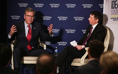 Jeb Bush, left, participates in a discussion with the Editor of the National Review, Rich Lowry during the National Review Institute 2015 Ideas Summit April 30, 2015 in Washington, DC. photo credit: Alex Wong/Getty Images/AFP)