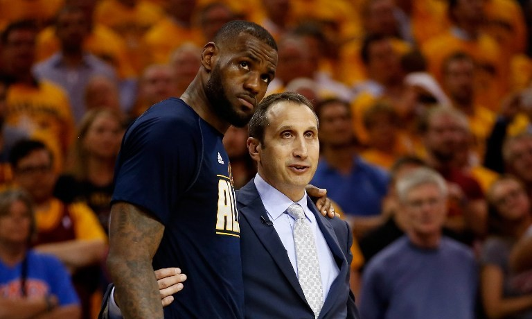 84f14b1f2881 LeBron James #23 of the Cleveland Cavaliers and head coach David Blatt  speak late in