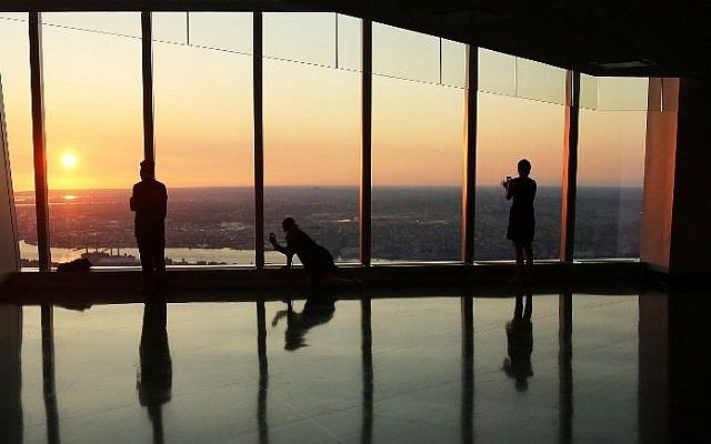 People view the sunrise at the newly built One World Observatory at One World Trade Center on the day it opens to the public on May 29, 2015 in New York City. (Spencer Platt/Getty Images/AFP)