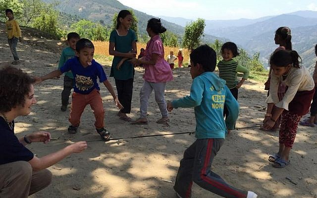 The only useful thing I did in Nepal: play with kids waiting for family members being treated at the IsraAID mobile clinic in a remote mountain village. (photo courtesy IsraAID)