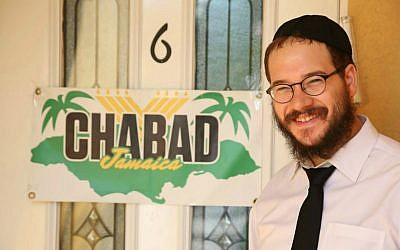 Rabbi Yaakov Raskin in front of the Chabad House in Montego Bay, Jamaica. (Courtesy)