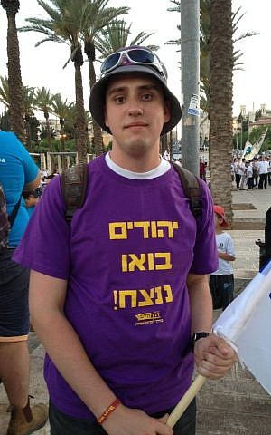 "Vlad, 20, wears a t-shirt reading ""Jews, let's win!"" (Elhanan Miller/Times of Israel)"