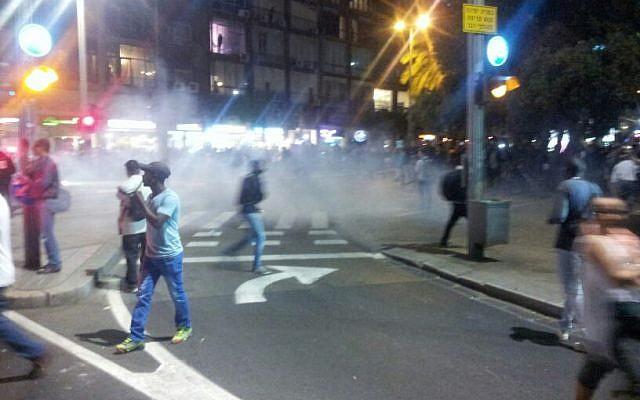 Smoke fills Rabin Square as police hurl stun grenades on May 3, 2015 (photo credit: Judah Ari Gross/Times of Israel)