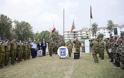 Israeli and Nepalese officers take part in a ceremony marking the end of operations of the IDF field hospital in Kathmandu, Nepal, on Sunday, May 10 2015. (Photo credit: IDF)