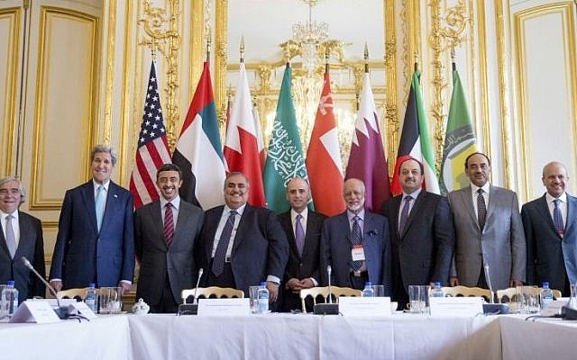 Secretary of State John Kerry (2nd left) and Foreign Ministers of the Gulf Cooperation Council pose for photographers at the Chief of Mission Residence in Paris, France, to discuss Middle East concerns about an emerging nuclear deal with Iran, May 8, 2015. (AP/Andrew Harnik, Pool)