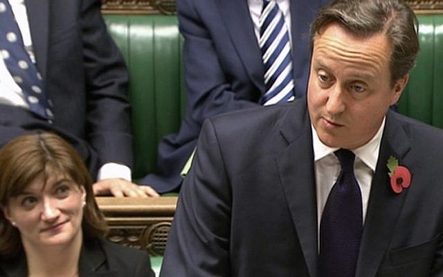 Nicky Morgan, the UK Secretary of State for Eduction, alongside Prime Minister David Cameron in the House of Commons, October 2014 (AP Photo/Parliamentary Recording Unit via AP)