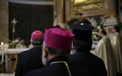 Armenian Catholic Archbishop of Aleppo Boutros Marayati, center, the Patriarch of Antioch and all the East of the Syrians Ignatius Joseph III Yonan, right, and Bishop Matteo Zuppi stand during a vigil to call for peace in Ukraine, Syria and all countries tormented by persecutions and war, at the Santa Maria ai Monti church in Rome, Wednesday, April 15, 2015 (AP/Gregorio Borgia)