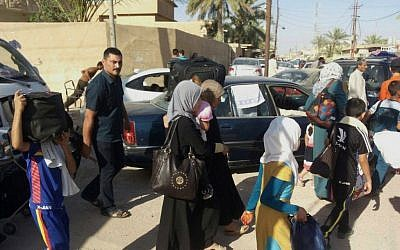 Civilians flee their hometown of Ramadi, the capital of Iraq's Anbar province, 115 kilometers (70 miles) west of Baghdad, Monday, May 18, 2015. Islamic State militants searched door-to-door for policemen and pro-government fighters and threw bodies in the Euphrates River in a bloody purge Monday after capturing the strategic city of Ramadi, their biggest victory since overrunning much of northern and western Iraq last year. (AP)