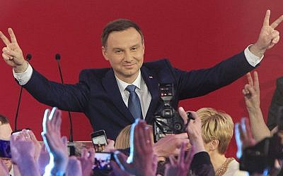 Opposition candidate Andrzej Duda celebrates his victory (AP Photo/Czarek Sokolowski)