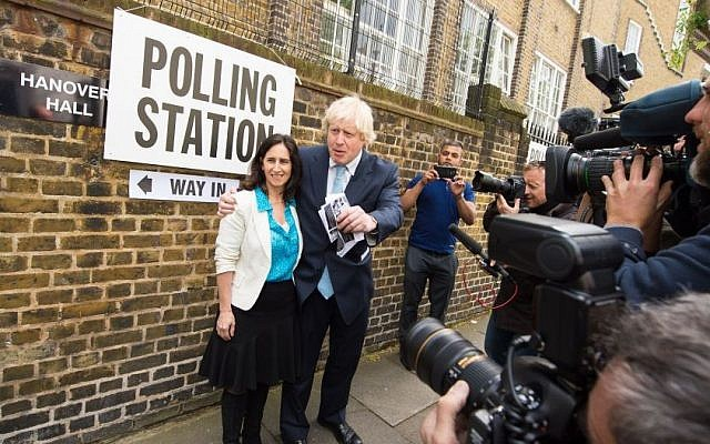 The Mayor of London, Boris Johnson and his wife Marina Wheeler, leave a polling station in Islington, north London, after voting the in the General Election, Thursday May 7, 2015. (photo credit: Dominic Lipinski/PA via AP)