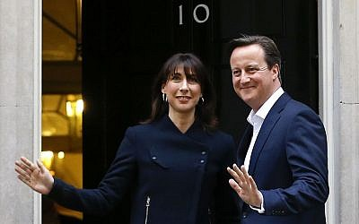 Britain's Prime Minister David Cameron and his wife Samantha return to 10 Downing Street in London, Friday, May 8, 2015, having won the previous day's elections. (photo credit: AP Photo/Kirsty Wigglesworth)