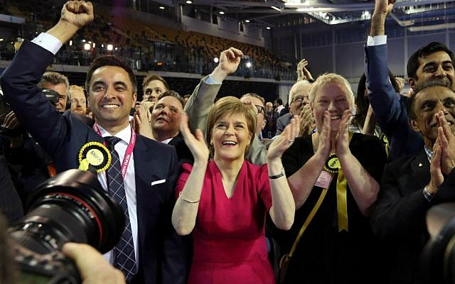 First Minister of Scotland and Scottish National Party leader Nicola Sturgeon, second left, celebrates with the results for her party at the count of Glasgow constituencies for the General Election, Glasgow, Scotland, Friday, May 8, 2015. (AP Photo/Scott Heppell)