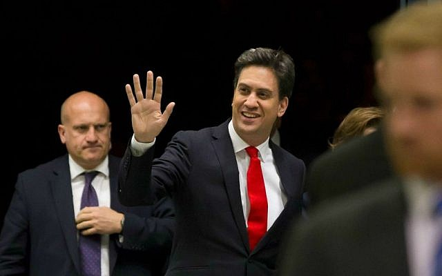 File: Labour Party leader Ed Miliband, center, arrives at Doncaster Racecourse as results come in after voting closes in Britain's general election, in Doncaster, England, Friday May 8, 2015. (AP Photo/Jon Super)