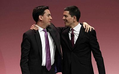 In this Monday, Sept. 27, 2010, file photo, Ed Miliband, left, the then newly-elected leader of Britain's opposition Labour Party, embraces his brother David Miliband, right, following David's speech on foreign policy during the party's annual conference, in Manchester, England. (photo credit: AP/Lefteris Pitarakis)
