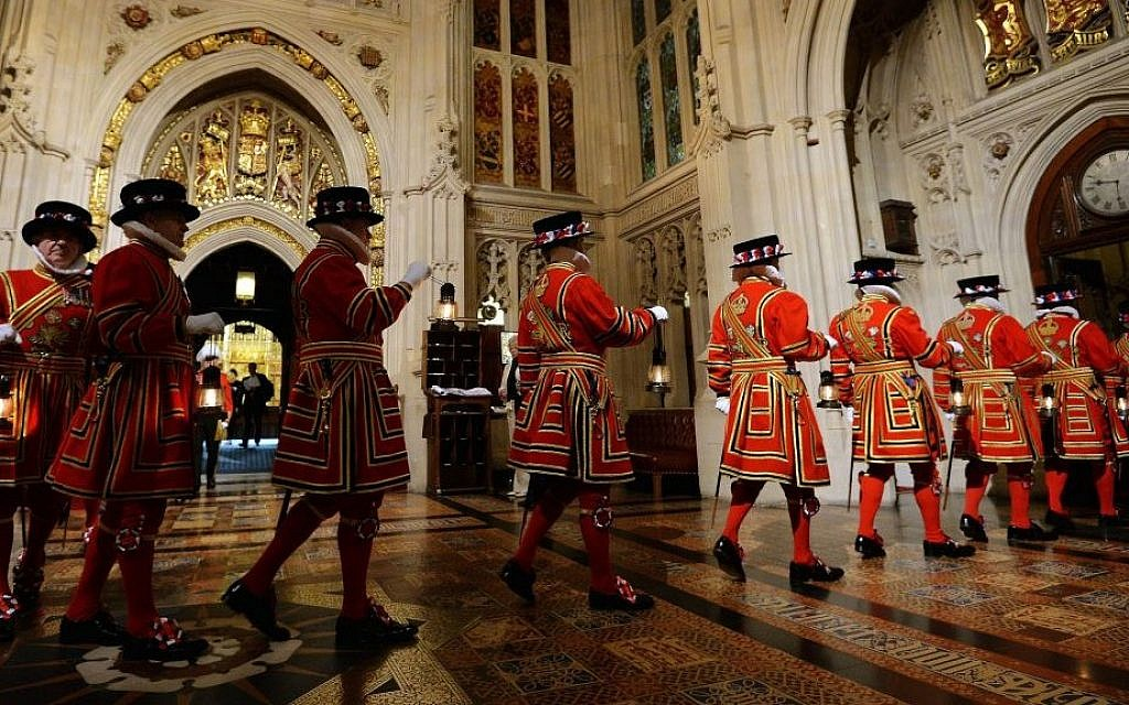 Yeoman of the Guard pass through the Peer's Lobby during the ceremonial search ahead of the State Opening of Parliament, in the House of Lords at the Palace of Westminster in London Wednesday May 27, 2015. (John Stillwell/AP)