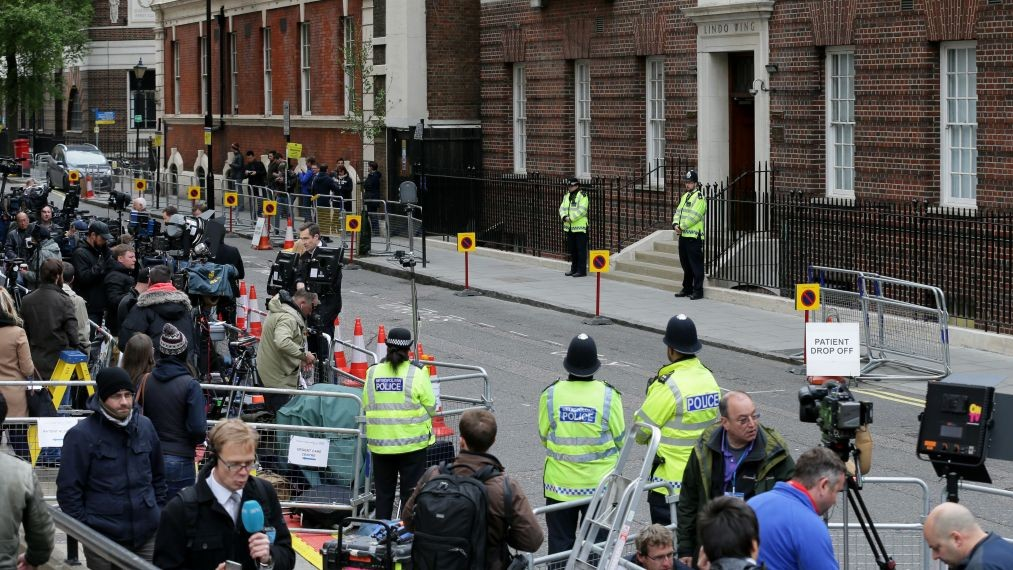 Members of the media gather outside the Lindo Wing at St. Mary's Hospital in anticipation of Kate, Duchess Cambridge giving birth to her second child, London, Saturday, May 2, 2015. (Photo credit: AP/Tim Ireland)